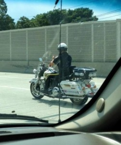 Police officer texting while riding